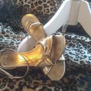 Kate Spade gold ankle strap sandals.
